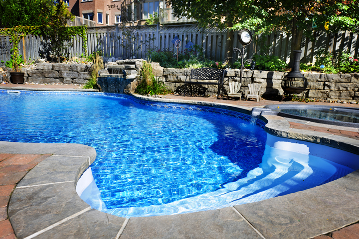 Bergen County swimming pool with pavers and waterfall