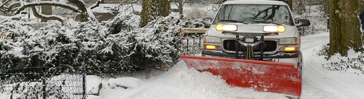 commercial snow plow remvoing snow in Bergen County